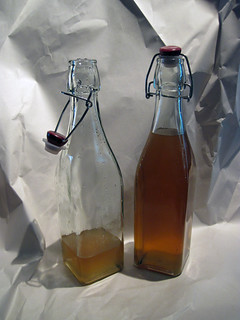 Two bottles of Finished Pear and Ginger Vodka