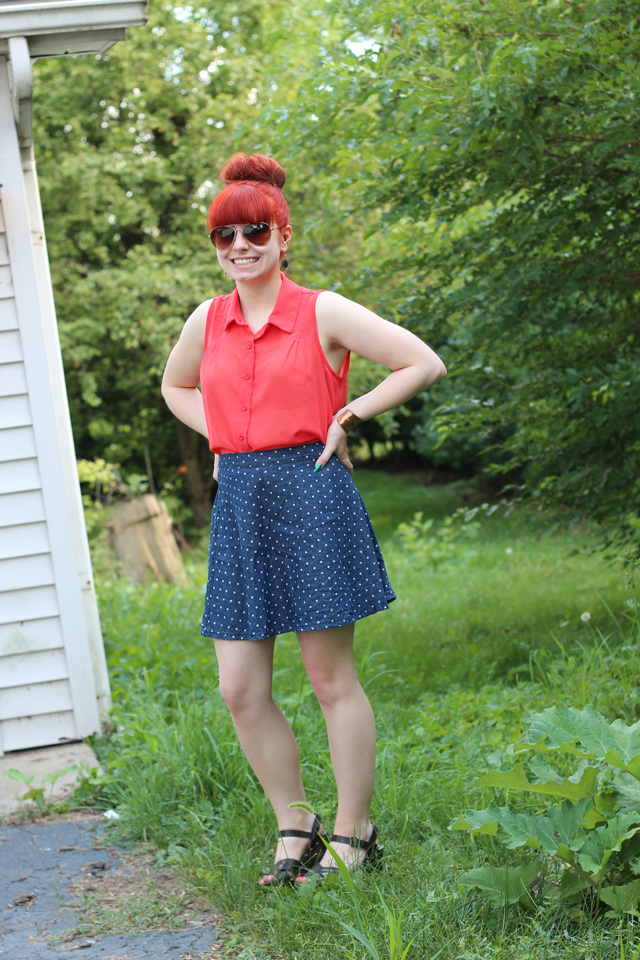 orange sleeveless top and denim polka dot skirt