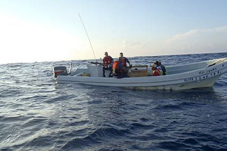 Coast Guard crew members take control of a Mexican lancha caught fishing illegally in U.S. waters, Nov. 20, 2013. The catch was disposed of at sea and the four fishermen were transferred to U.S. Customs and Border Protection. U.S. Coast Guard photo..