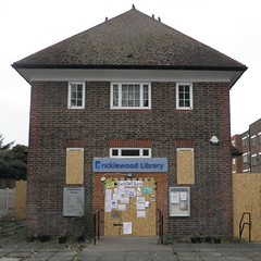 Cricklewood library with boarded-up entrance and windows
