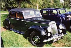 packard super eight(0.0), rolls-royce silver dawn(0.0), touring car(0.0), automobile(1.0), packard 120(1.0), rolls-royce phantom iii(1.0), vehicle(1.0), antique car(1.0), sedan(1.0), classic car(1.0), vintage car(1.0), land vehicle(1.0), luxury vehicle(1.0), motor vehicle(1.0),