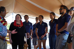 Under Secretary for Economic Growth, Energy, and the Environment Cathy Novelli listens to the crew of the traditional Polynesian double-hulled canoe Hōkūleʻa during their visit to Washington, D.C., on May 24, 2016. The Polynesian Voyaging Society Mālama Honua Worldwide Voyage is taking the iconic sailing canoe Hōkūleʻa around the world to help build a global movement toward a more sustainable ocean and planet. [State Department photo/ Public Domain]