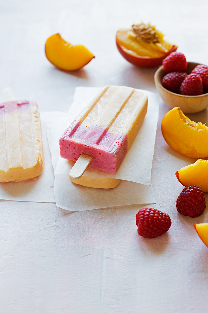 Nectarine Raspberry Frozen Yogurt Pops--these naturally sweetened popsicles are just 4-ingredients: fresh nectarines and raspberries, plain greek yogurt, and honey!