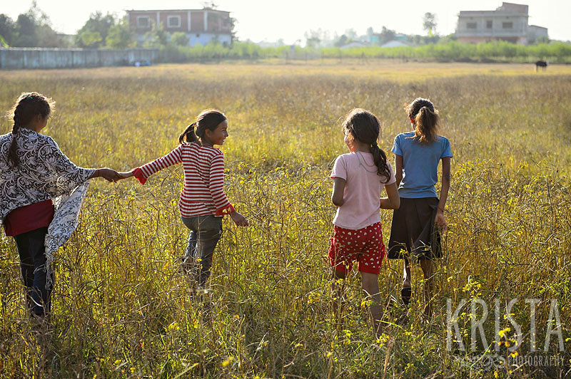 Nepalese Girls walking in a field