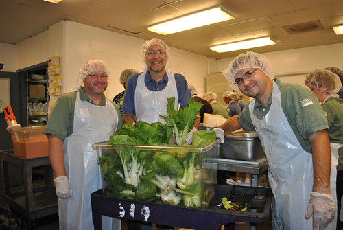 (L to R) DC Central Kitchen in Washington, D.C. Rich Holcomb employee, U.S. Department of Agriculture (USDA) National Agricultural Statistics Service (NASS) Brian Lounsbury, and USDA, National Institute of Food and Agriculture (NIFA) Dewell Delgado Paez stand with a bin of just washed bok choy that was grown USDA headquarters Peoples Garden in Washington, D.C. USDA photo.
