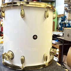 Finishing up a nice little white high gloss with brass hardware drum set tonight. #qdrumco  #goldmakesitlookrich
