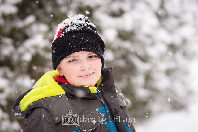 Photo of a child outside in the snow