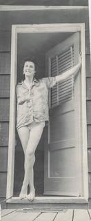 Woman stands in a doorway