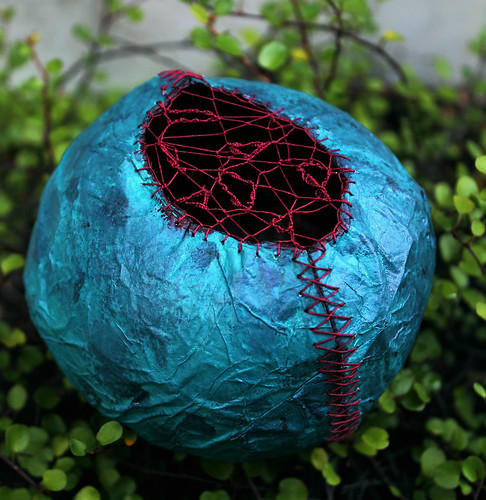 Blue Tissue Paper Cocoon with Red Stitching