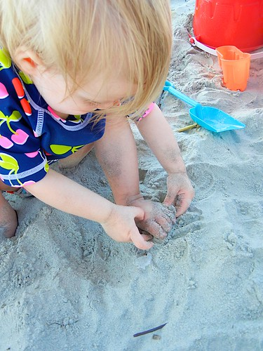 Trying to get the sand out of her toes. LOL