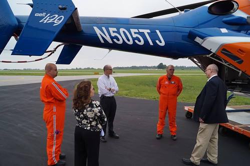 Deputy Under Secretary Doug O'Brien (center, white shirt), N.Y. State Director Stanley Lee Telega (right) and USDA Area Specialist Dawn Kauras visit the new state-of-the-art Mercy Flight Helicopter. Mercy Flight offers emergency services to rural residents throughout Western New York. USDA provided funding support. USDA photo.
