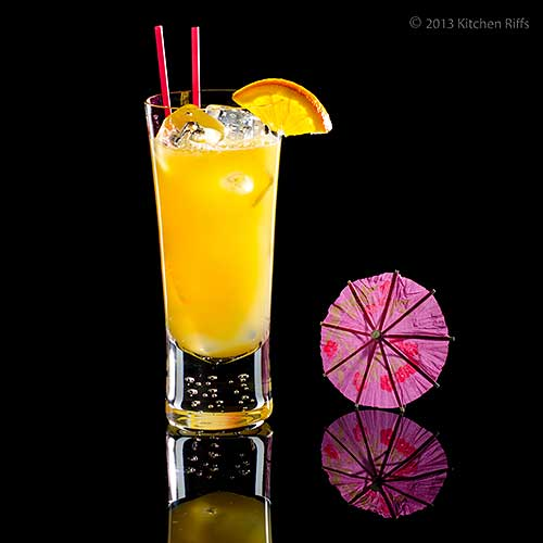 Scorpion Cocktail with orange slice garnish and cocktail umbrella