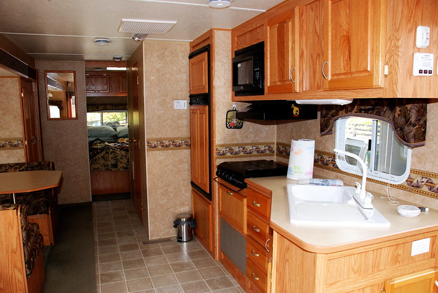 Kitchen w/ Fridge, Stove & Microwave