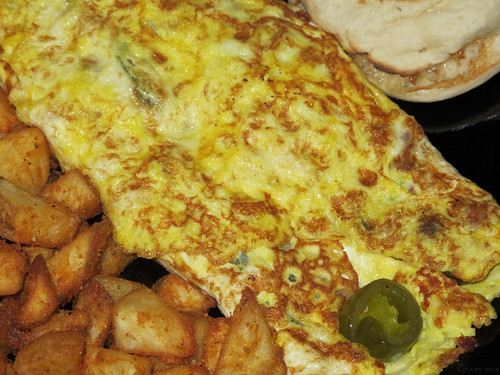 Bacon, jalapeno, and mozzarella omelet by Coyoty