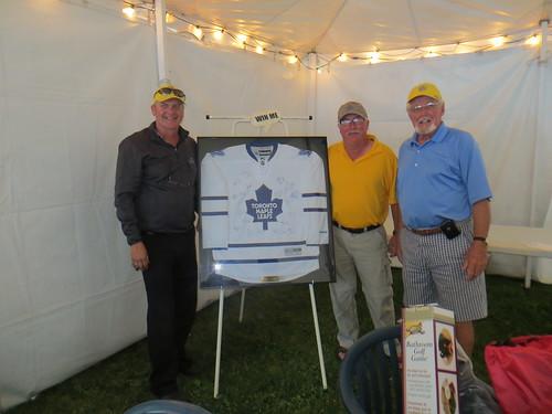 Don Neil(centre) won the Maple Leaf jersey. Presenting the jersey are Kim Muszynski from the Albion Hotel on the left and Lion President Larry Simpson on the right.