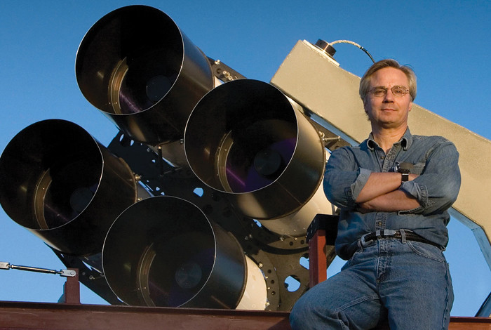 Los Alamos National Laboratory astrophysicist Tom Vestrand poses with a telescope array that is part of the RAPTOR (RAPid Telescopes for Optical Response) system. RAPTOR is an intelligent visual system that scans the skies for optical anomalies and zeroes in on them when it detects them. This unique capability allowed the system to witness the rare birth of a black hole in the constellation Leo recently.