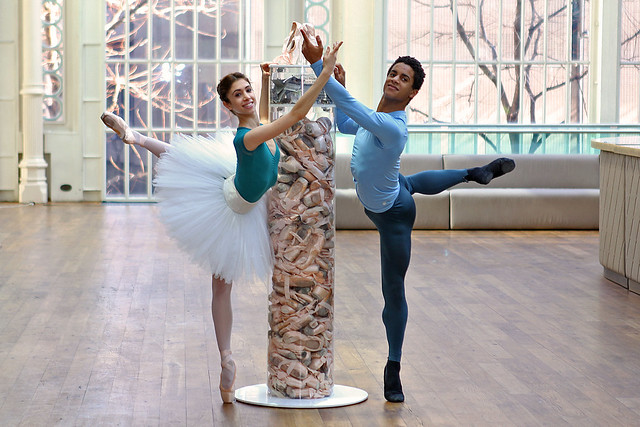 Yasmine Naghdi and Marcelino Sambé with our Pointe Shoe Tower - showing the number of pointe shoes used by The Royal Ballet in a week © ROH/Ruairi Watson, 2014