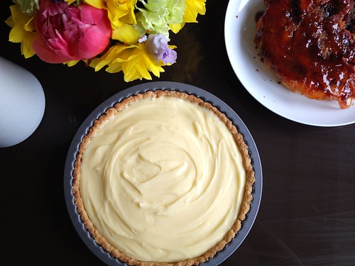 lemon tart, with blood orange cake looking on