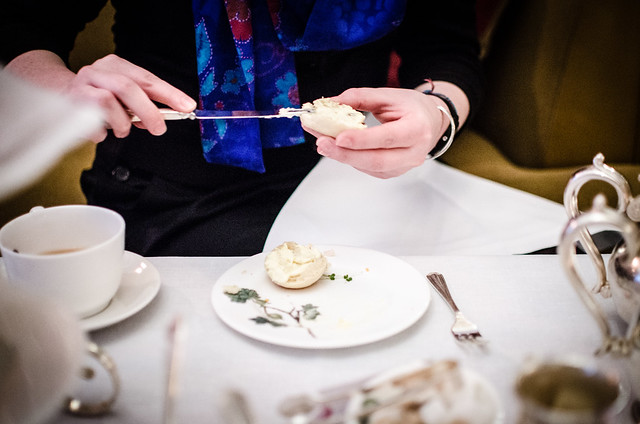 A fresh scone gets the clotted cream treatment at the Brown's Hotel.
