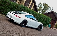 executive car(0.0), porsche panamera(0.0), convertible(0.0), automobile(1.0), wheel(1.0), vehicle(1.0), performance car(1.0), automotive design(1.0), porsche 911(1.0), porsche(1.0), land vehicle(1.0), luxury vehicle(1.0), supercar(1.0), sports car(1.0),