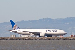 United Airlines Boeing 777-200 N784UA taxiing for takeoff, runway 28, SFO P1013528