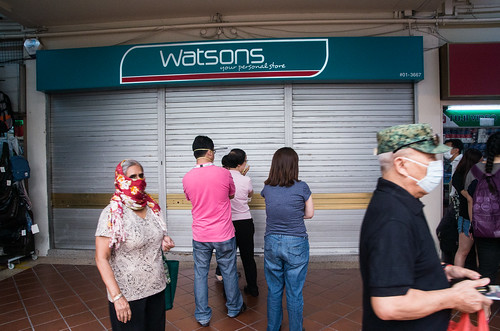 Queuing up for masks - shoppers waiting for a local pharmacy to open to buy N95 masks - a wave of panic buying has seen these masks sold out across the country