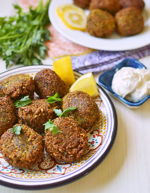 Homemade falafel made with dried chickpeas is crisp on the outside and soft and tender in the middle. Serve with creamy tahini yogurt stuffed in pita.