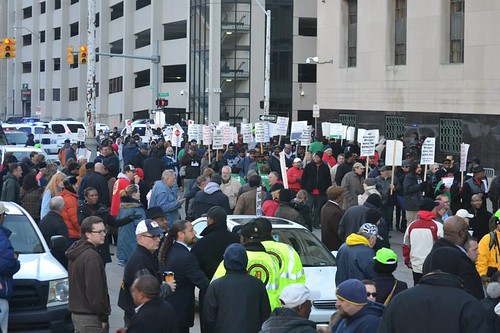 Crowds outside the bankruptcy trial in Detroit on Wednesday October 23, 2013. People are demanding that the proceedings be halted. by Pan-African News Wire File Photos