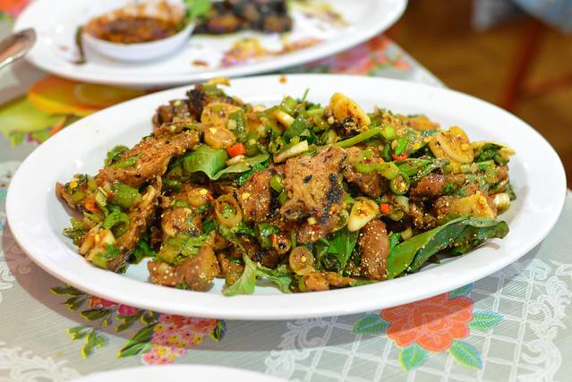 moo sadoong 'startled pig' grilled pork, basil, lemongrass, raw garlic, fish sauce, lime, chile