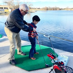 Keep you eye on the ball! Opa and David hitting at the Waxahachie Country Club. Their driving range is a pond and their balls float!