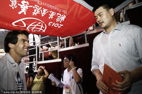 July 1st, 2013 - Brazilian soccer star Kaka talks to Yao at the Yao Foundation charity game in Beijing