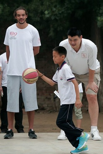 June 30th, 2012 - Yao Ming and Joakim Noah visit a  primary school for children of migrant workers at Changping District in Beijing