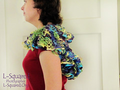 side view of the shawl being modeled - covers shoulders and all of upper back.