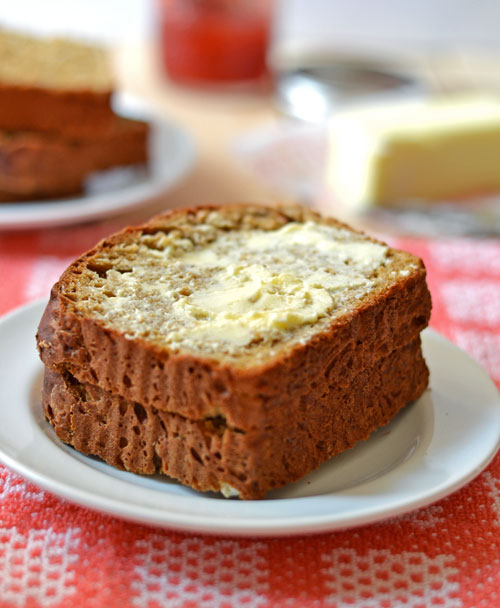 Two oatmeal bread slices slathered with butter