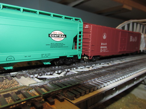 A 1960's era American freight train in H.O scale passes by. by Eddie from Chicago