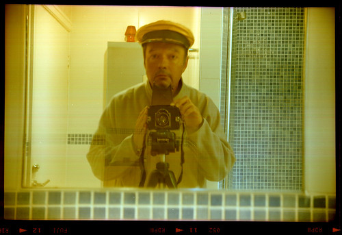 reflected self-portrait with K W Box-Reflex camera and gold cap by pho-Tony