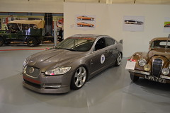 model car(0.0), automobile(1.0), automotive exterior(1.0), executive car(1.0), wheel(1.0), vehicle(1.0), performance car(1.0), automotive design(1.0), auto show(1.0), jaguar xf(1.0), sedan(1.0), land vehicle(1.0), luxury vehicle(1.0), supercar(1.0), sports car(1.0),