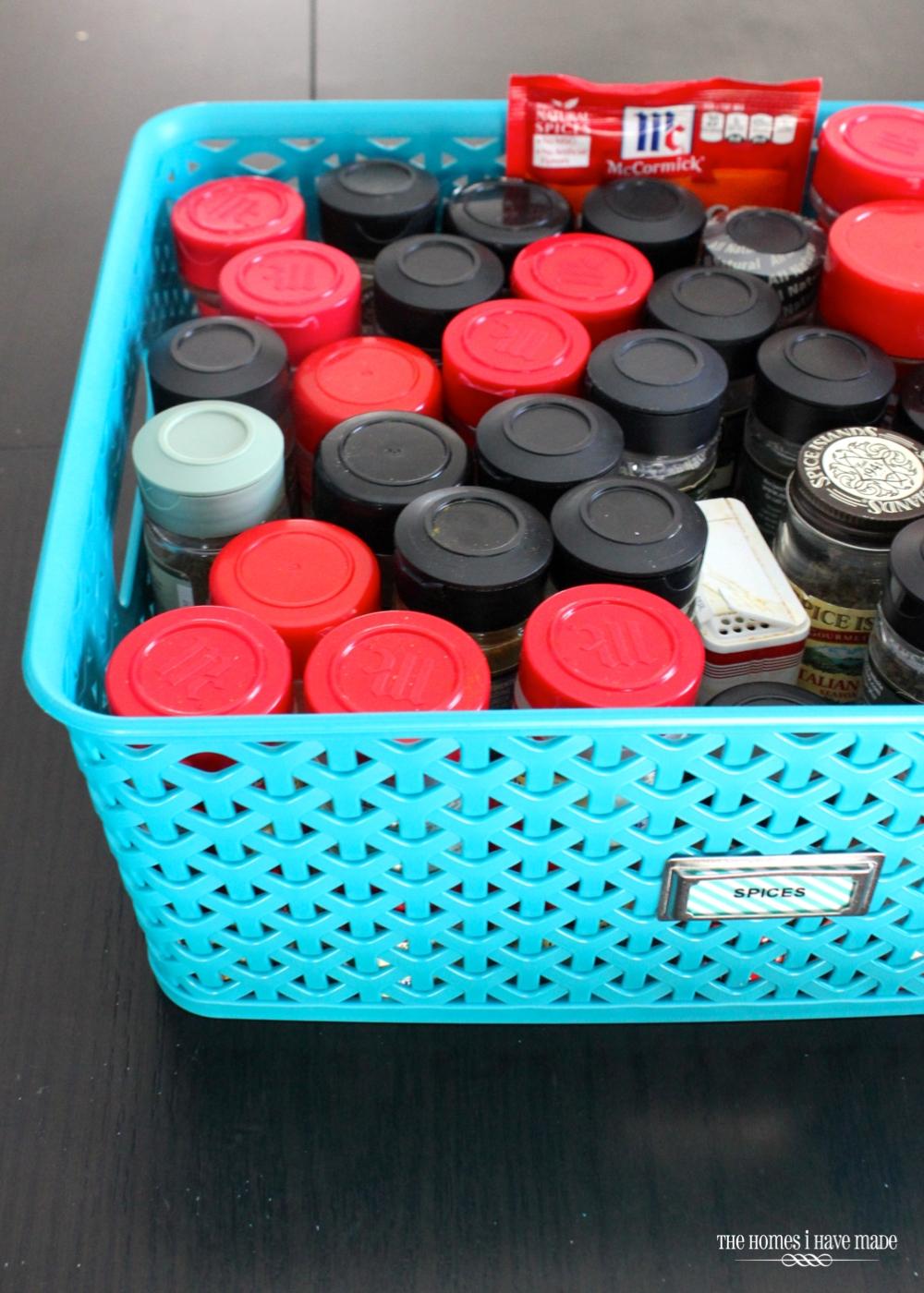 blue basket containing spice jars