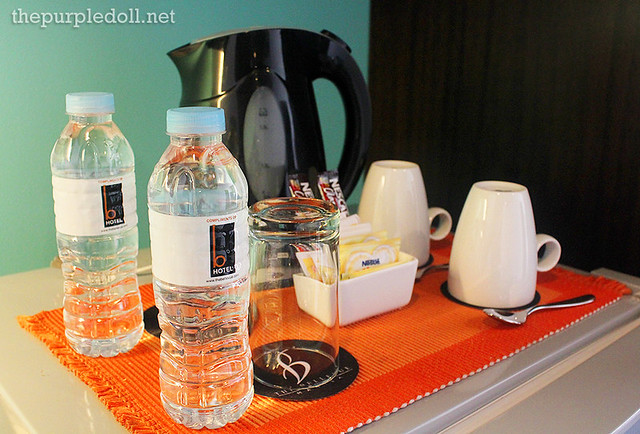 B Hotel Coffee and Tea Maker and bottled water