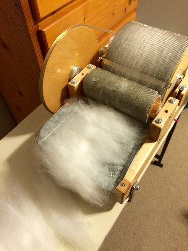 Second pass. Placing the aligned fibres back through for one more carding.