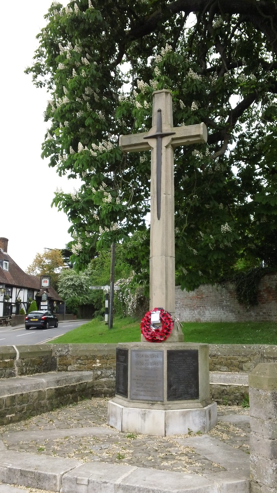 War memorial (Walnut Tree pub, background) Yalding, Kent