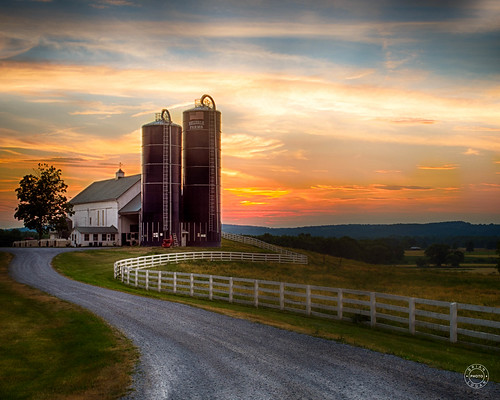 mountianside gravel landscape sunset dairy rural clouds trees historical barn ny silo house grass sky farm road warwick fence field newyork unitedstates us