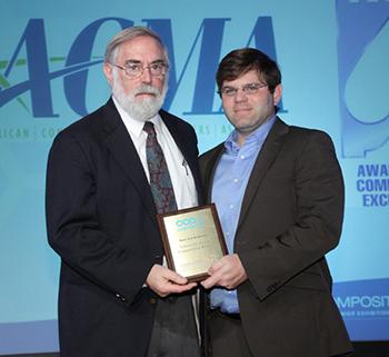 From left, professor emeritus Roy Broughton and David J. Branscomb, '12 doctoral graduate in polymer and fiber engineering