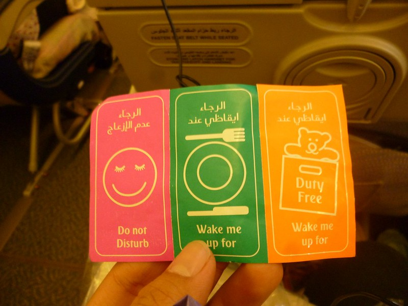 Stickers you stick on your seat so the cabin attendant knows to wake you up for food or leave you hungry.