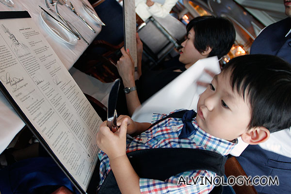 Asher looking at the menu