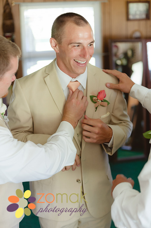 Groomsmen help the groom prepare before his wedding in Washington State
