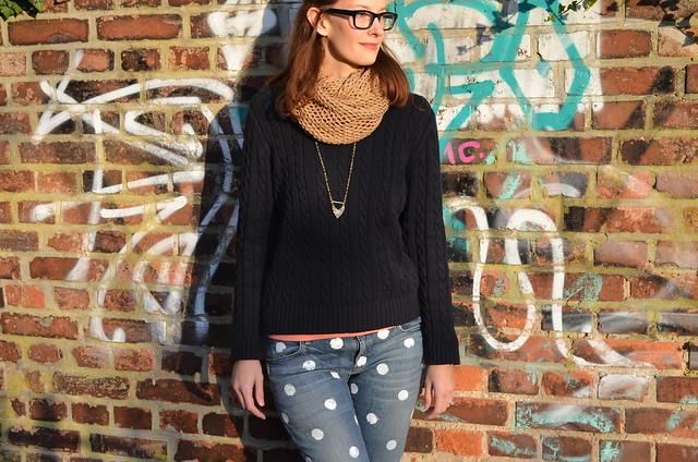 polka dot jeans on sunny brick wall