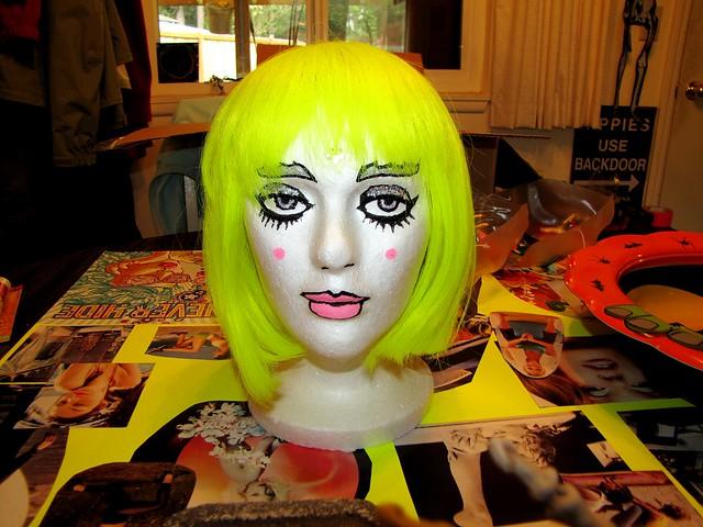 neon wig on wig head
