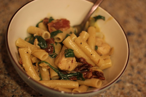 Pasta with garlic cream sauce, chicken, artichokes, spinach, sun dried tomatoes, bacon