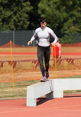 sprint(0.0), athletics(0.0), track and field athletics(0.0), jumping(0.0), long jump(0.0), hurdle(0.0), sport venue(1.0), obstacle race(1.0), sports(1.0), running(1.0), person(1.0), physical exercise(1.0), athlete(1.0),
